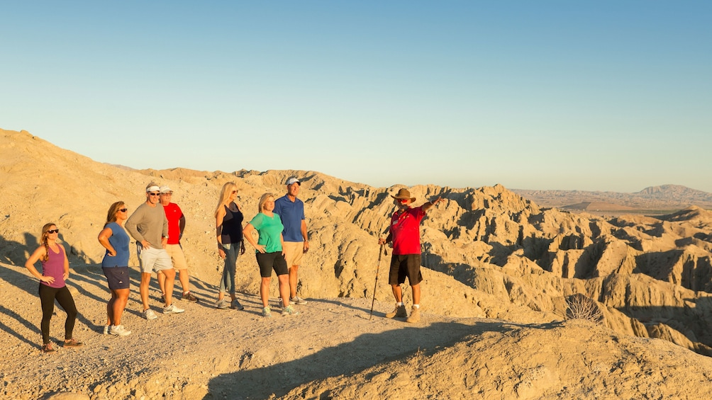 Show item 3 of 5. Guide with tour group in the hills of Palm Springs