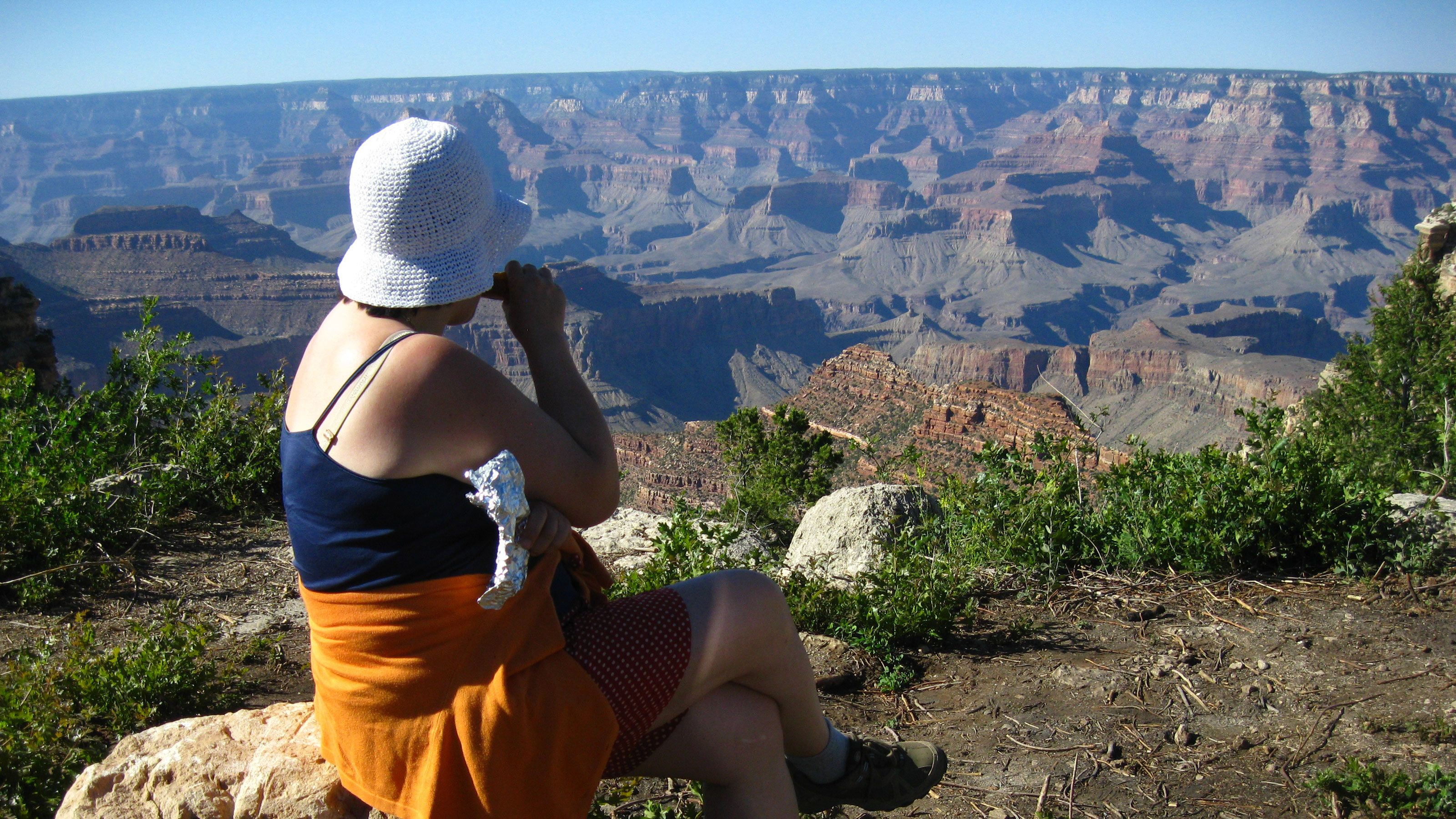 Woman enjoying the majestic view of the Grand Canyon