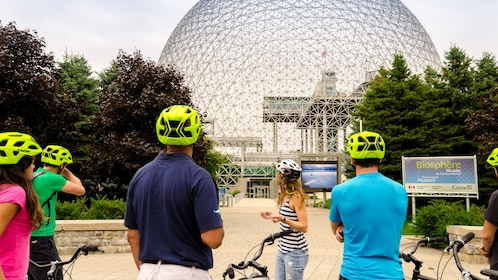 Day view of a group enjoying a scenic cycling tour in Montrea