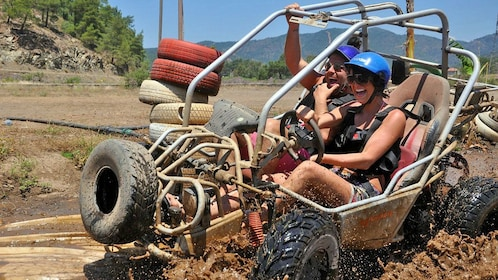 driving a buggy through muddy waters in Marmaris