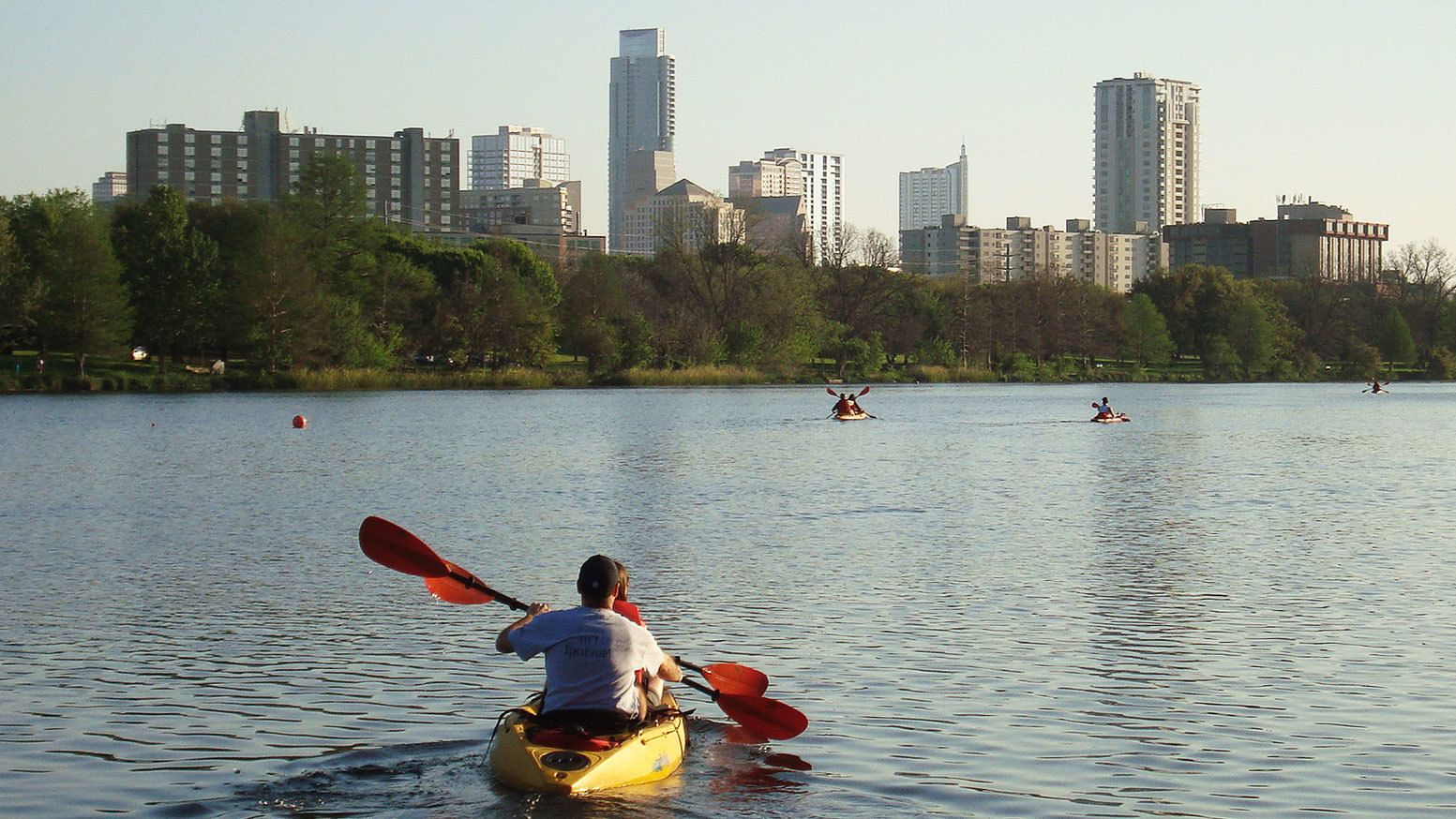 Kayakers paddling through river in Austin