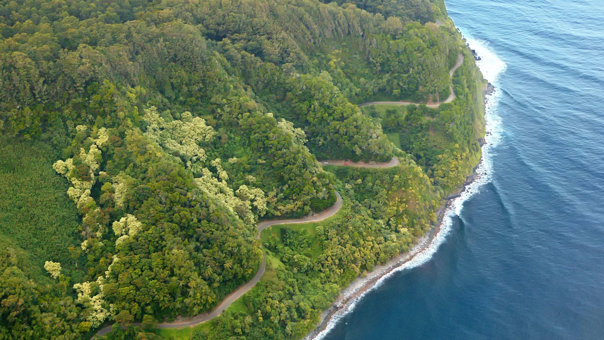 Aerial curvy road to the Hana Rainforest along the coast on the Hana & Haleakala Helicopter Tour in Maui