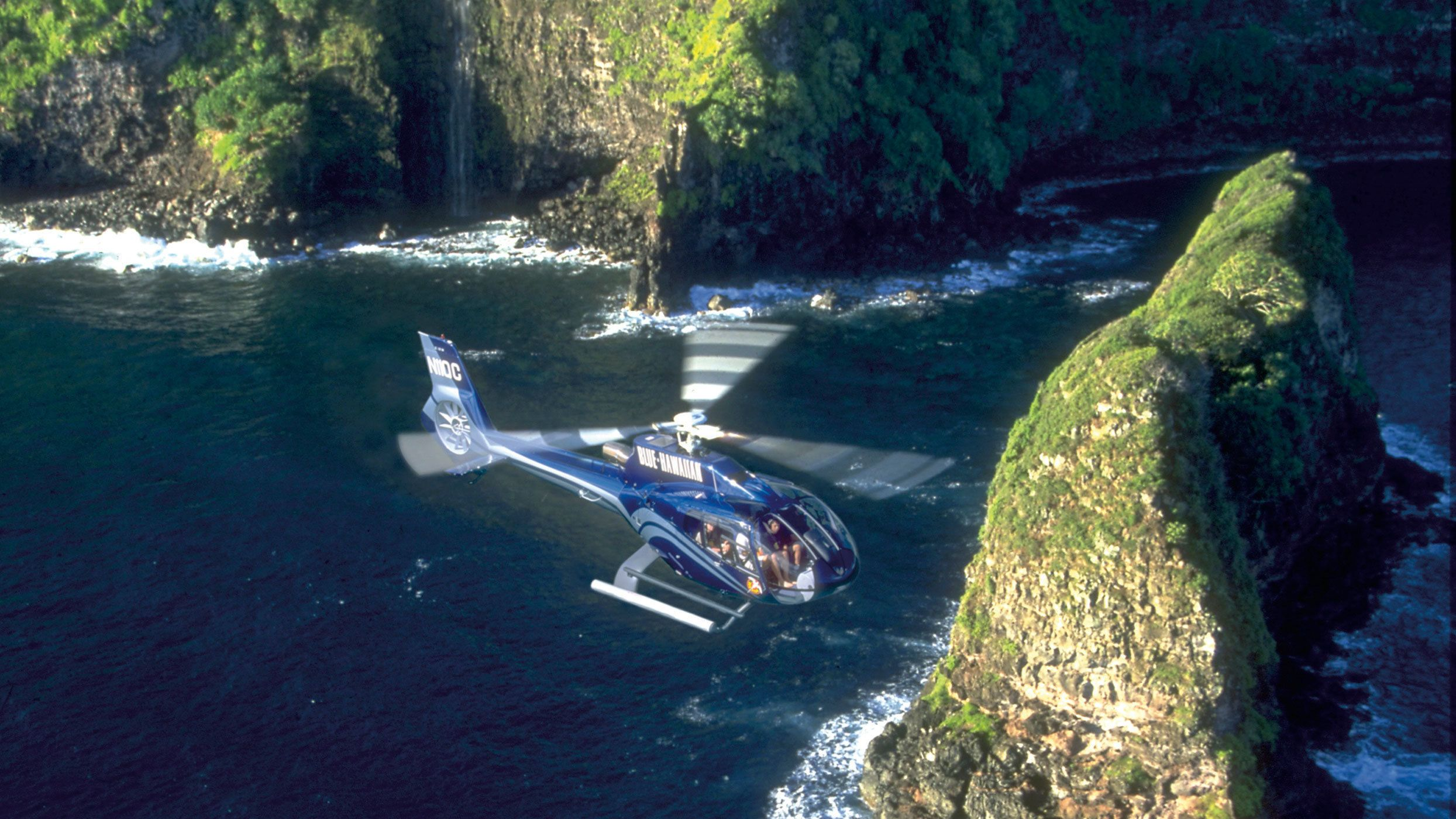 Hover over the Maui coastline to observe an aerial view of the island
