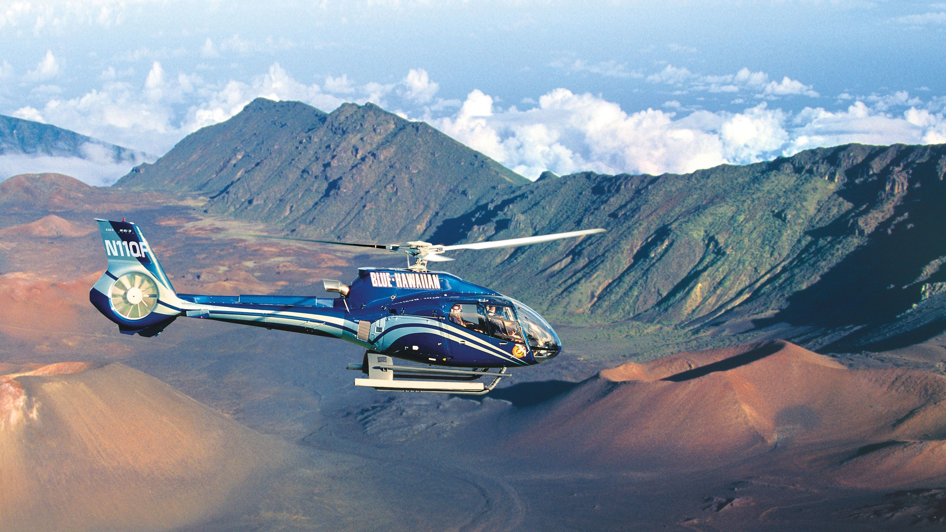 Ride in a helicopter over volcanic craters in Maui