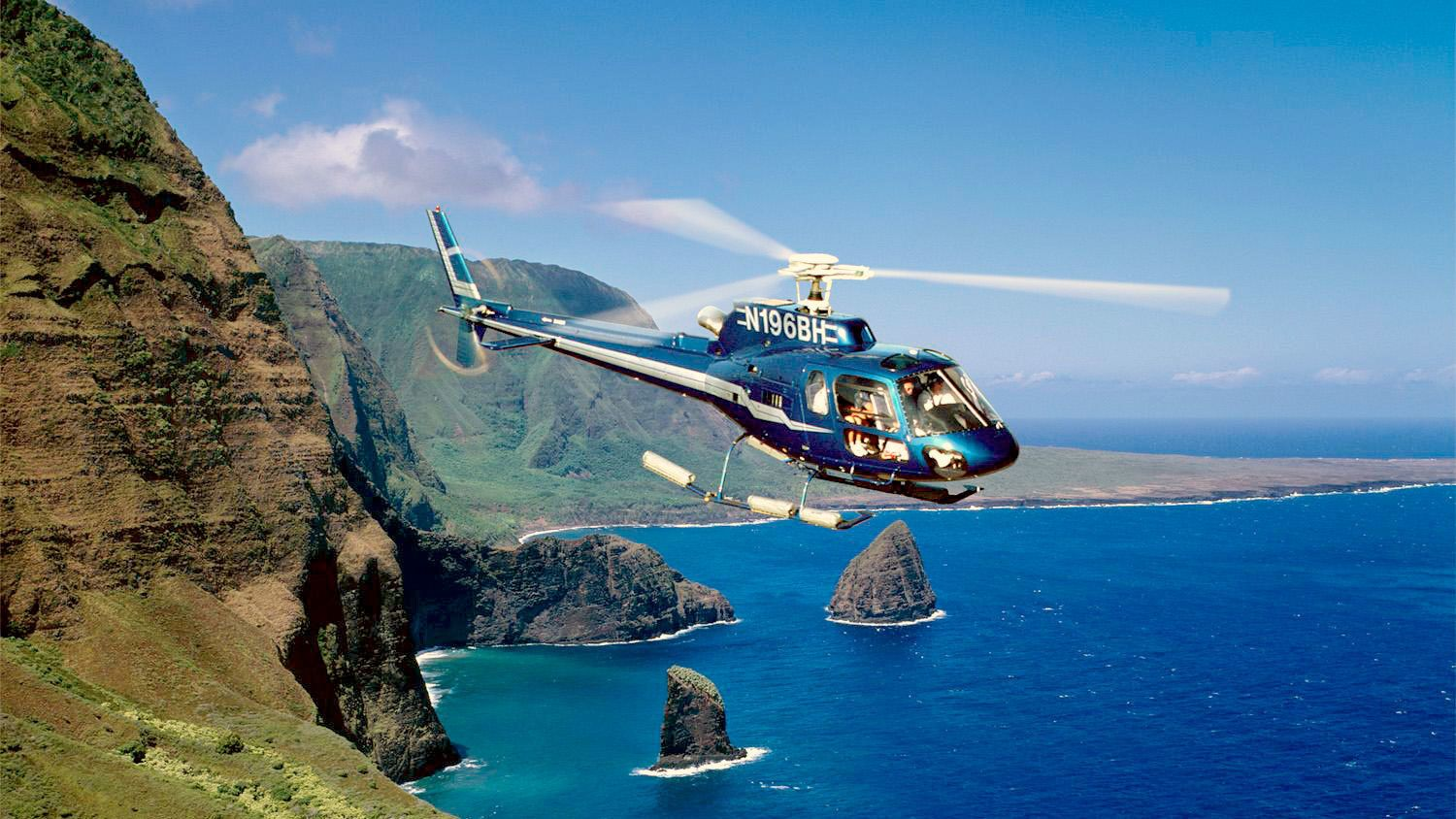 Molokai Seacliffs with rocks poking out of the water on the a Helicopter tour in Maui