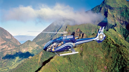 Mist covered peaks of West Maui on the Waterfalls & Molokai Seacliffs Helicopter Tour
