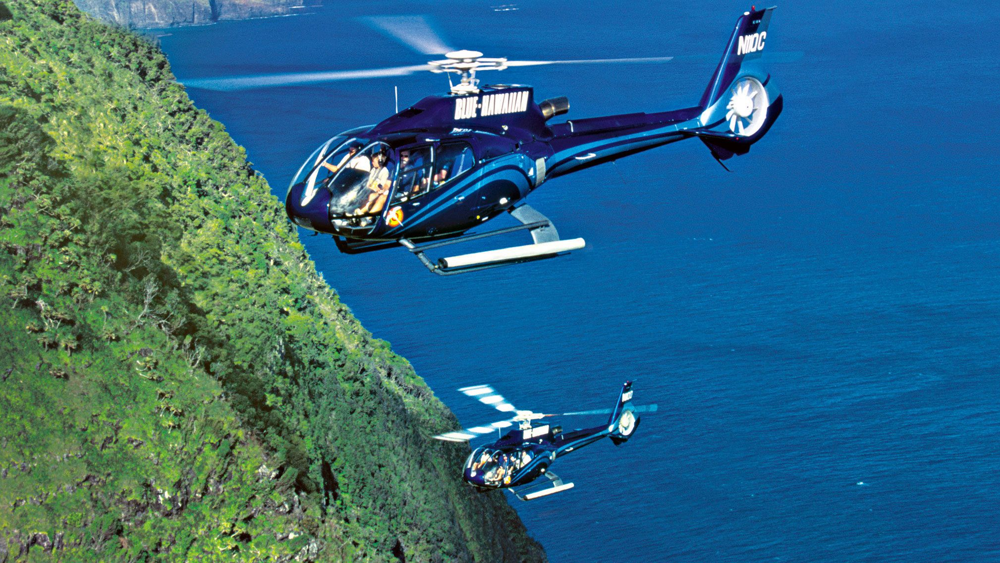 Two helicopters on near the seacliffs on the Waterfalls & Molokai Seacliffs Helicopter Tour in Maui