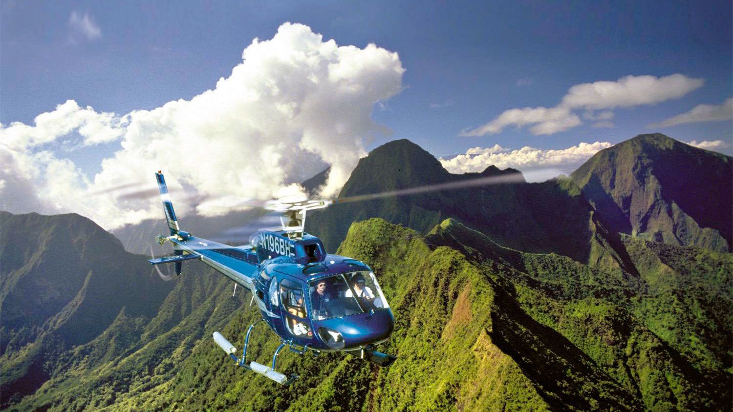 Green mountain peeks on the Waterfalls & Molokai Seacliffs Helicopter Tour in Maui