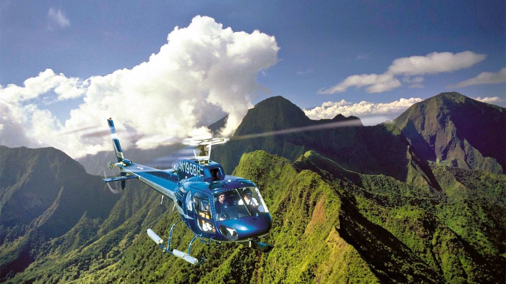 Show item 5 of 8. Green mountain peeks on the Waterfalls & Molokai Seacliffs Helicopter Tour in Maui