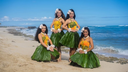 Hula dancers on a beach on Oahu