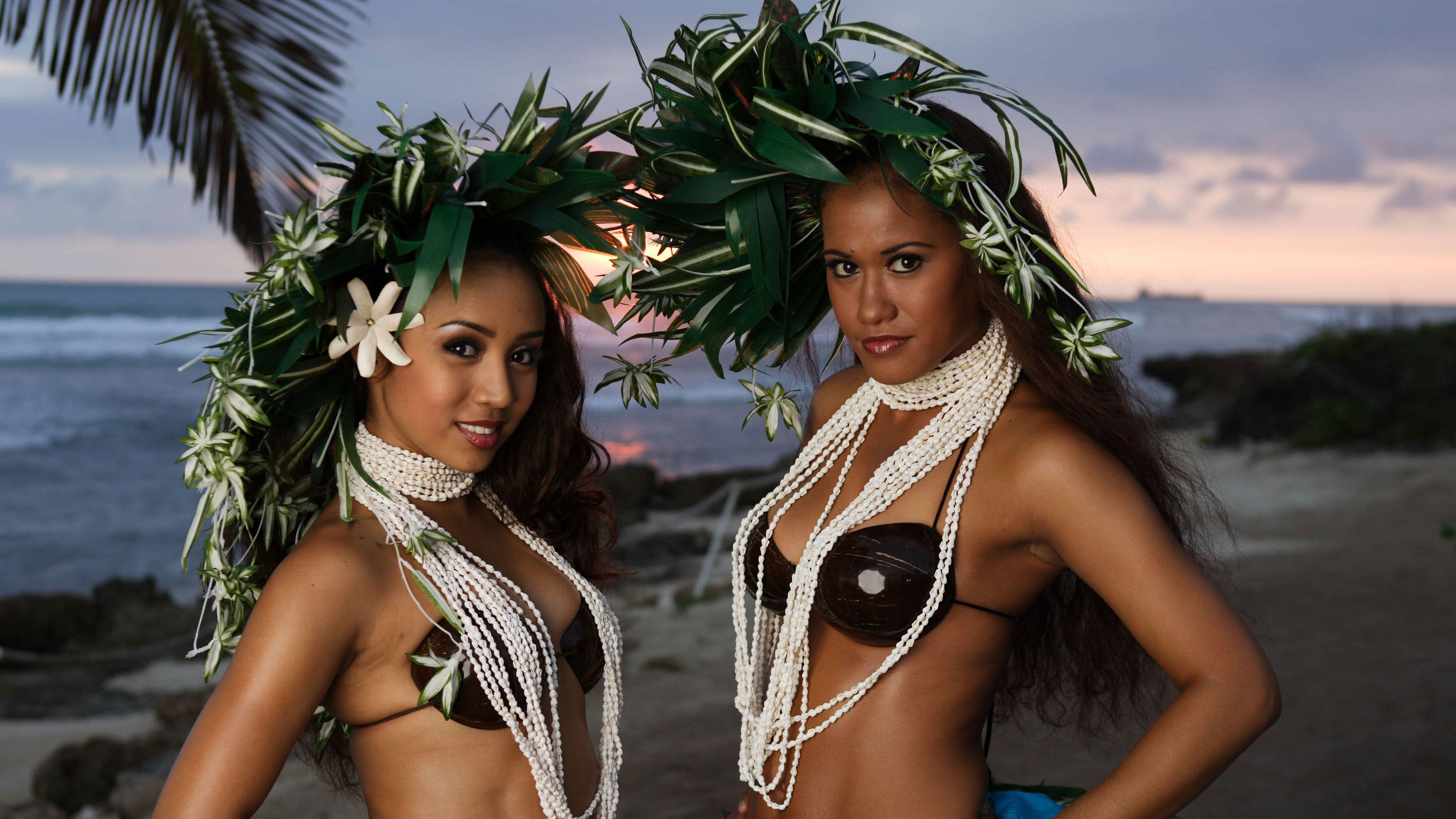Luau performers on beach with head dresses