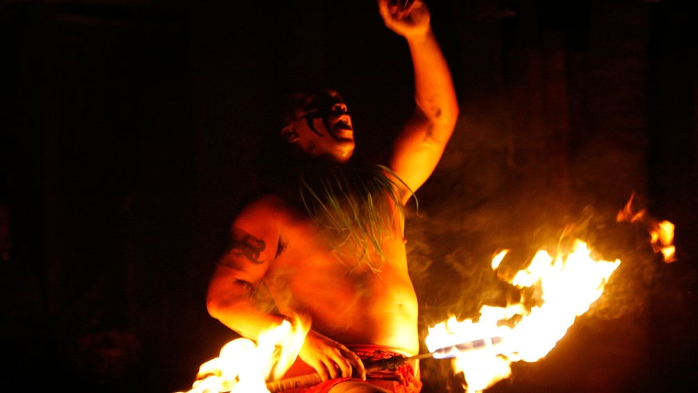 Show item 3 of 8. fire performer in Luau