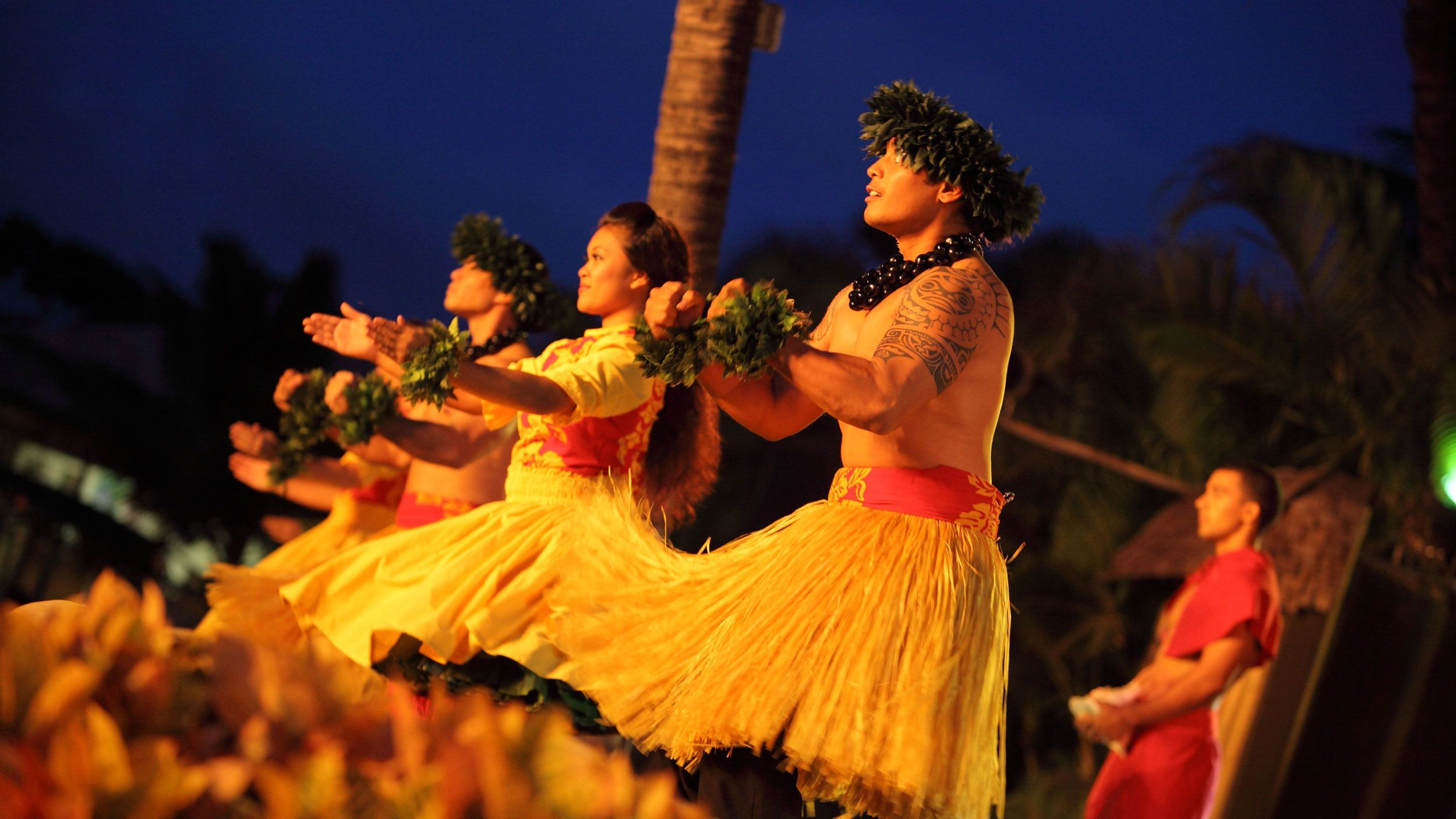 Luau performers in grass skirts