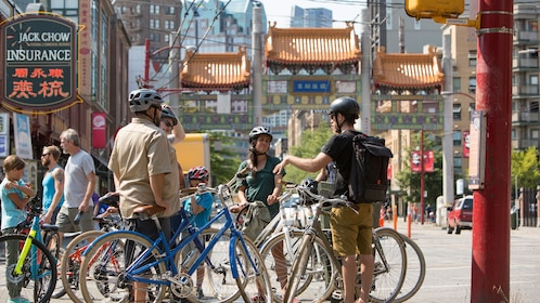 A group of bikers stop near the streets of Chinatown in Vancouver, BC