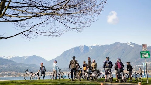 A group of bikersstop and view the mountains of Vancouver, BC