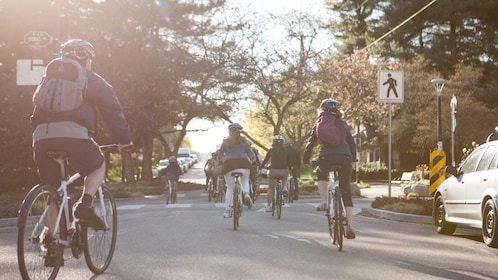 A group of bikers pedal through the streets of Vancouver, BC