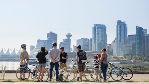A group of bikersstop and view the skyline of Vancouver, BC