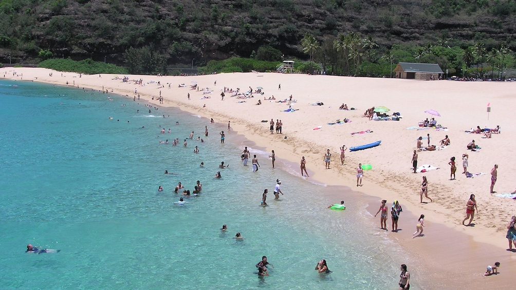 Show item 5 of 10. Beachgoers on the North Shore on Oahu