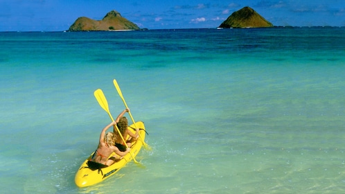 Pair of women kayaking in Oahu