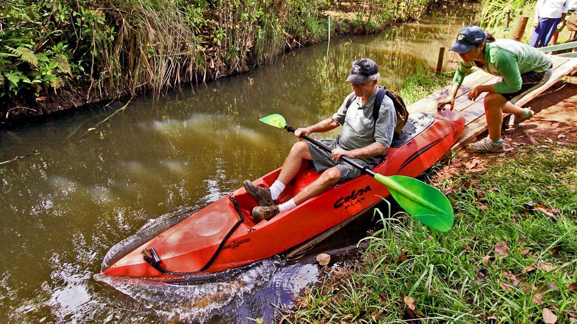 Man in Kayak casting off in Kauai