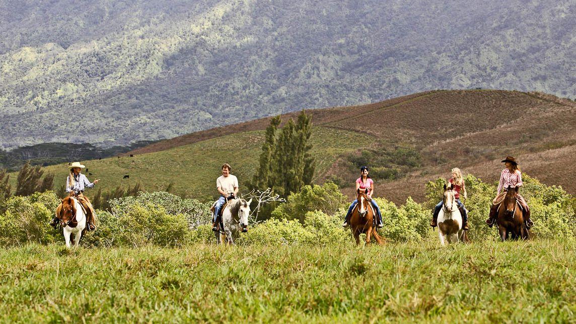 Riding group on trail in Kauai