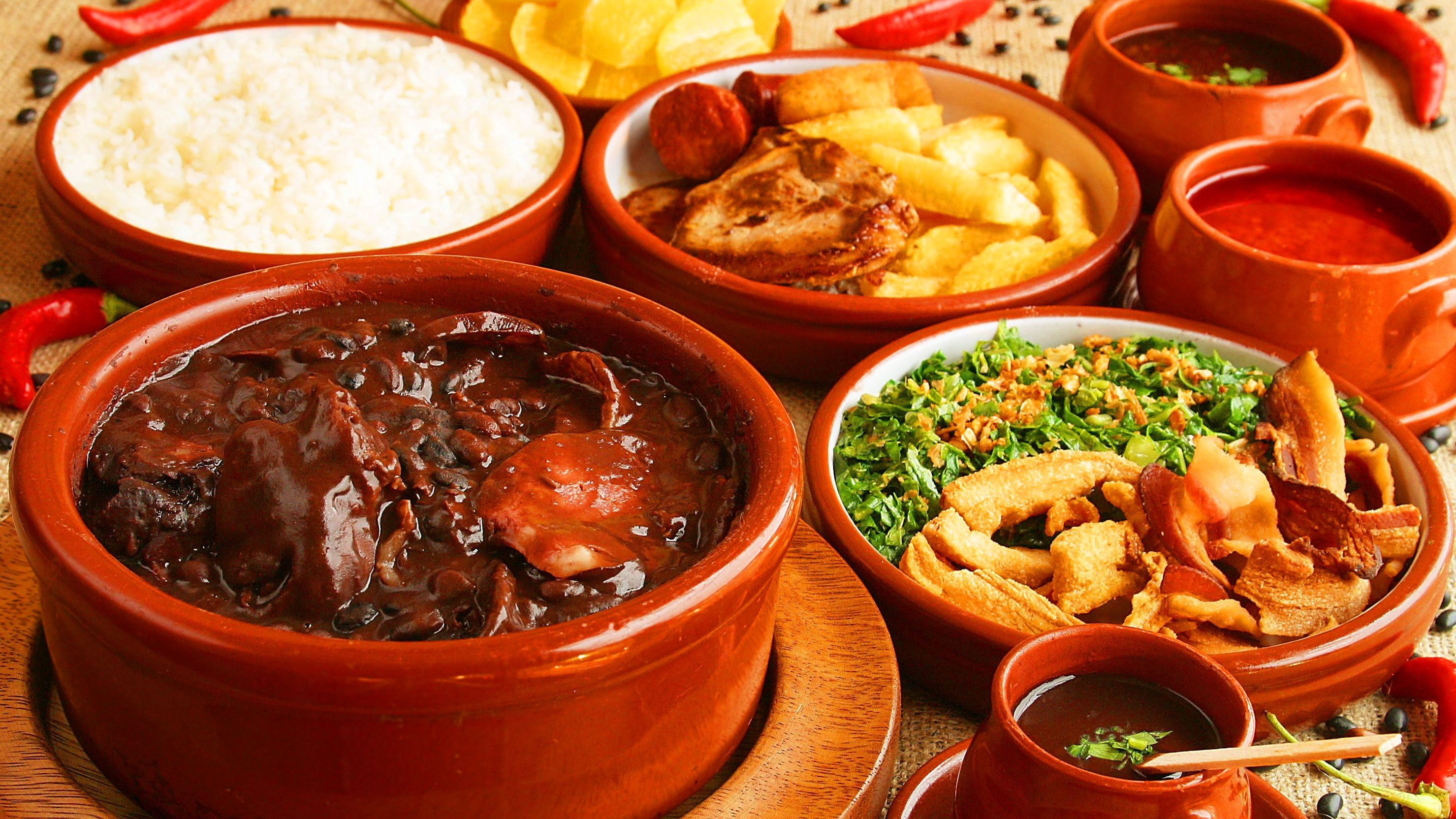 Bowls of Brazilian food on a table