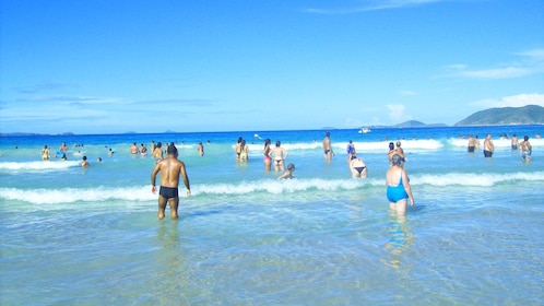 People in surf at Beach of Cabo Frio