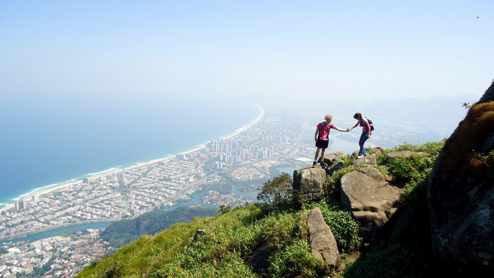 Couple on a lookout point with the city far below in Rio de Janeiro