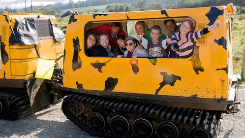 Hagglund passengers posing for a photo in New Zealand