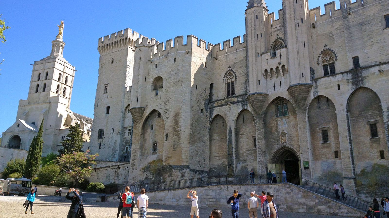 walking by old castle walls and towers in France