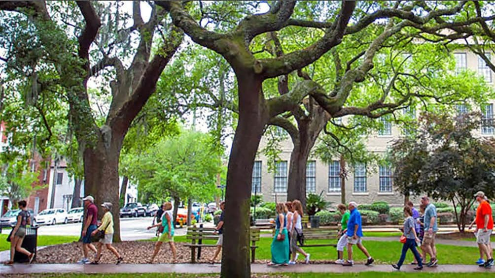 Show item 1 of 8. walking along a square in Savannah