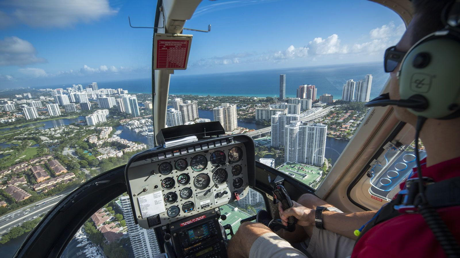piloting a helicopter above the city in Florida