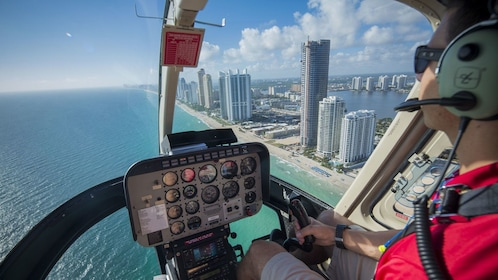 piloting a helicopter along the beachfront in Florida