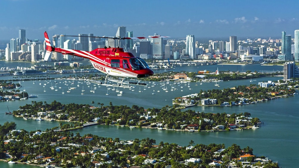 Show item 3 of 5. helicopter soaring above the coast in Florida