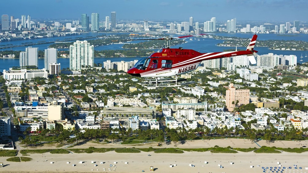 Show item 5 of 5. helicopter flying above the city in Florida