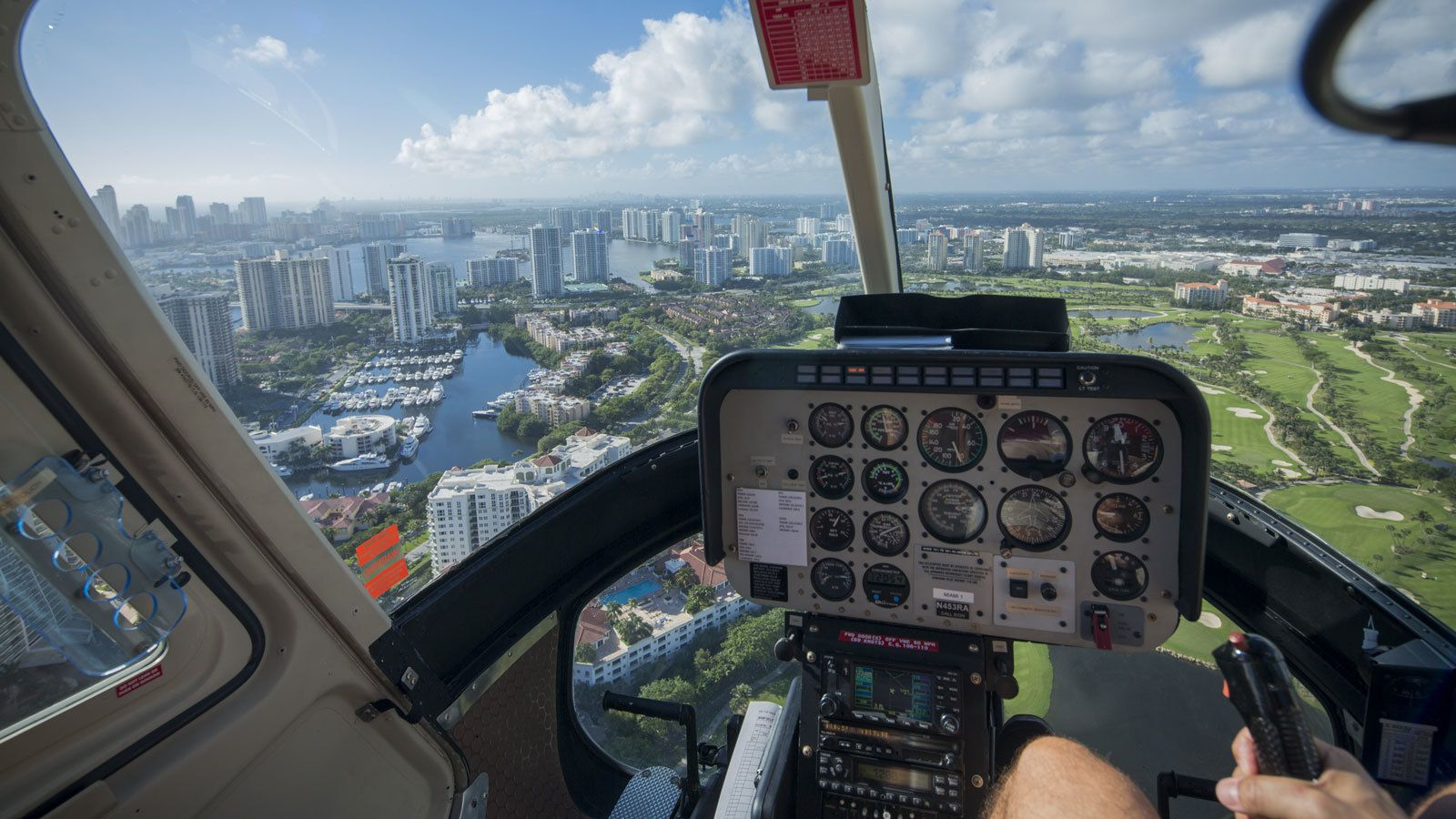 flying a helicopter around the city in Florida