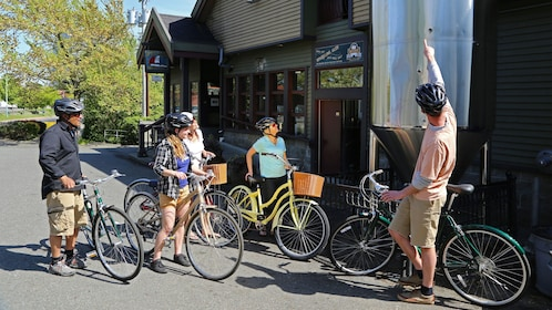 Bicycling group with tour guide outside a brewery in Victoria