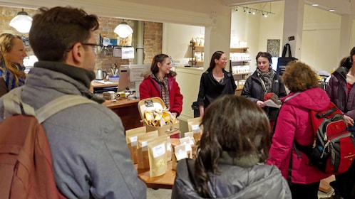 group learning about chocolate inside a store in Montreal