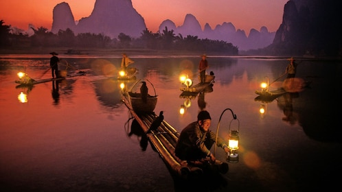 Boats with lanterns on the Li River at sunset in Guilin