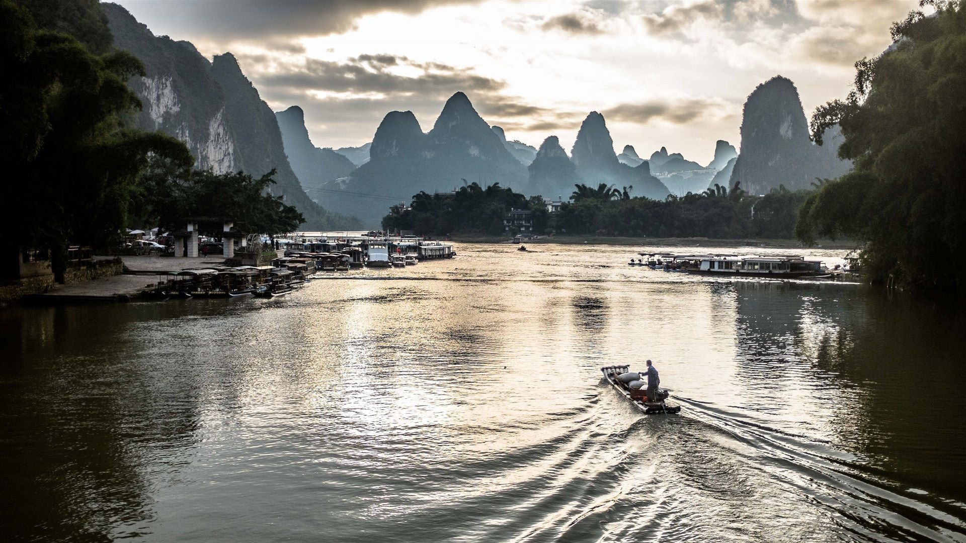 Boats on the Li River with mountains in the background near Yangshuo