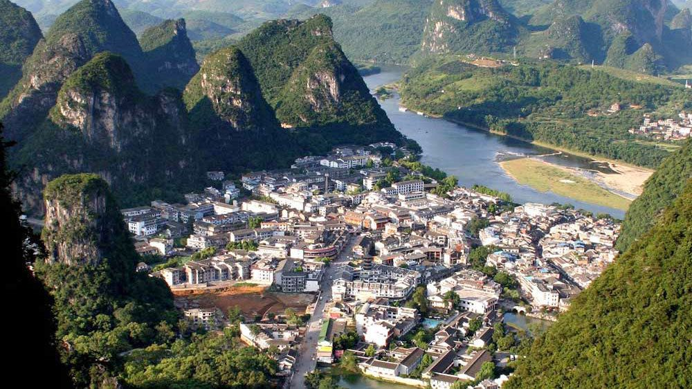 Town of Yangshuo nestled in the mountains along the river