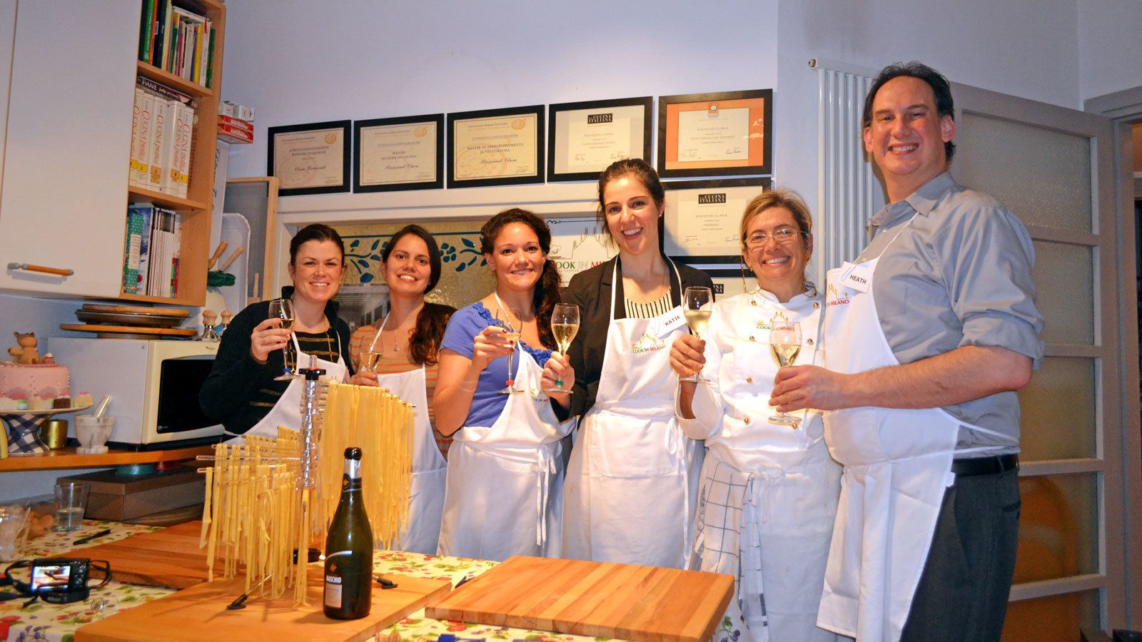 group having wine while cooking in Milan
