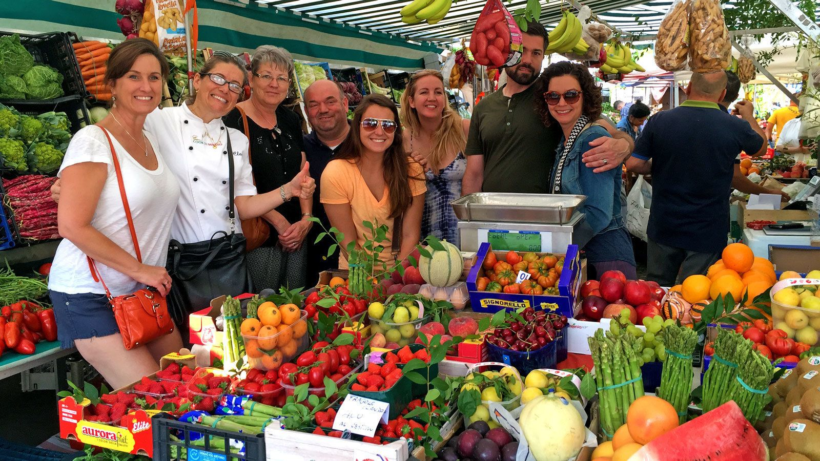 group visiting a market in Milan