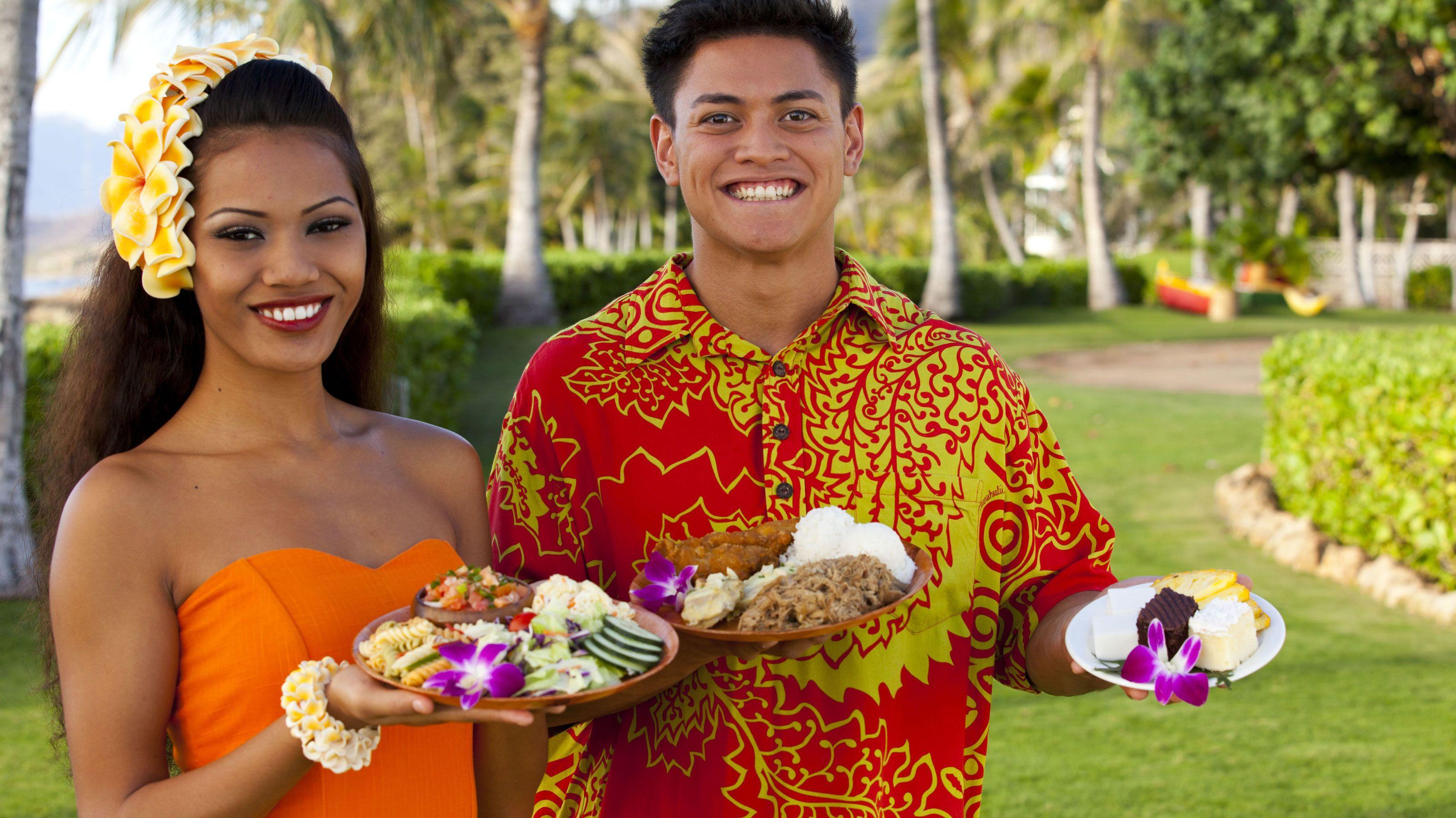 Luau hosts offering tasty food items