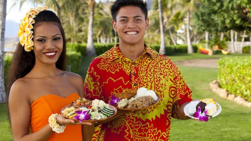 Luau hosts offering tasty food items