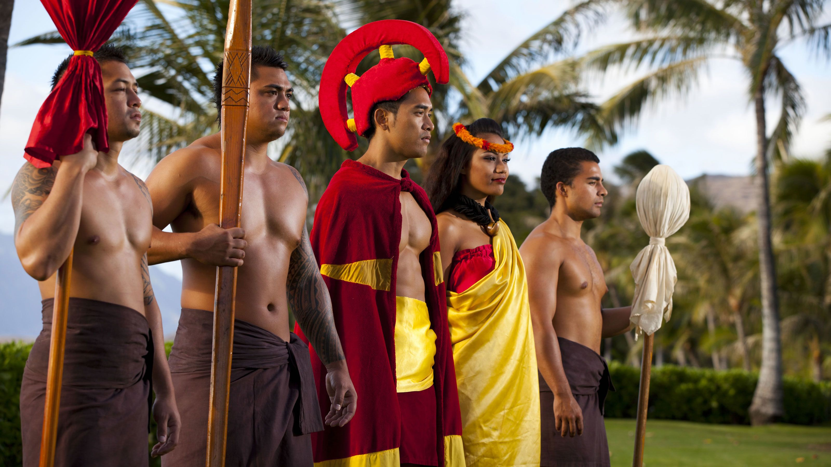 Luau performers in traditional dress in Oahu