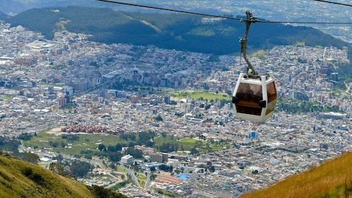 Gondola with city in the distance in Quito