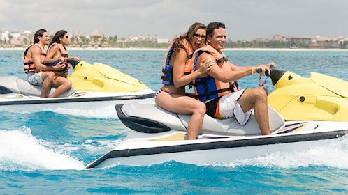 Couples riding Jet skis in Oahu