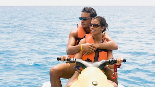 Couple enjoying view from Jet ski in Oahu