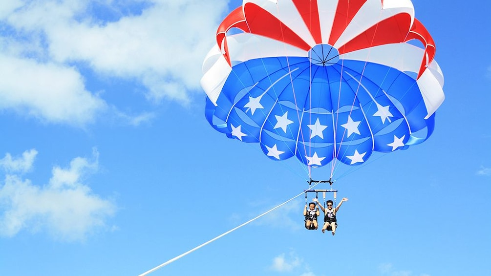 Show item 2 of 9. Friends on American flag parasail